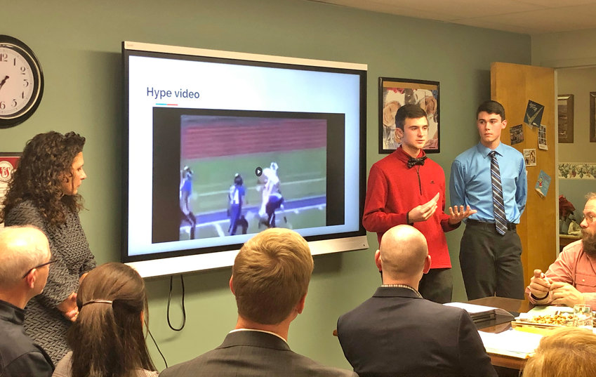 PRESENTATION FOR VVS BOARD — Vernon-Verona-Sherrill school district Library Media Specialist Tina Laramie and VVS students Gavin Miller and Robert Merrill give a presentation to the VVS Board of Education involving students' use of technology at the district's Sheveron Stadium.