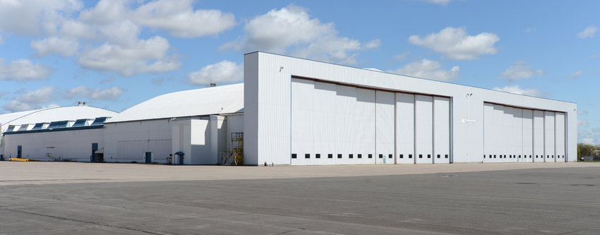 HANGAR SPACE —An exterior view of the hangar doors at Griffiss International Airport Building 101, where aircraft maintenance company Strategic Global Aviation plans to begin operations in January under a lease with Oneida County.