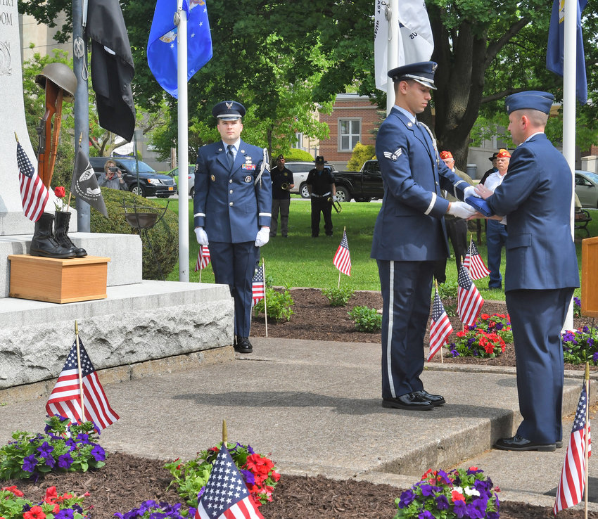 HONORING THE FALLEN —The Eastern Air Defense Sector Honor Guard, shown in this file photo performing the Retiring of the Colors during Memorial Day ceremonies, conducted dozens of funeral services in 2019 for deceased veterans.