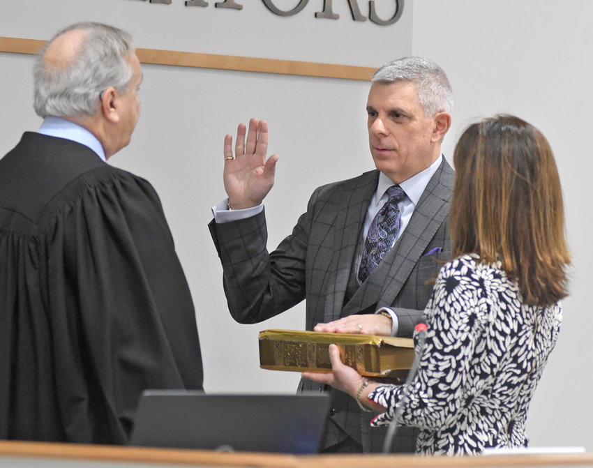 OATH OF OFFICE  — Oneida County Executive Anthony J. Picente Jr. with his wife Eleanor taking the oath of office administered by retired Utica City Court Judge John Balzano in the Board of Legislators Chambers on Monday, Dec. 30.