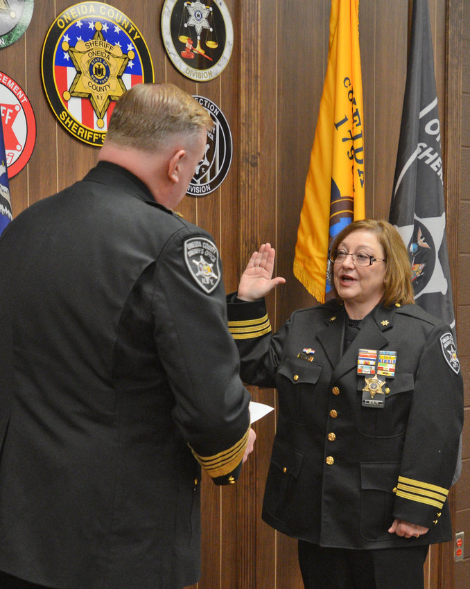 NEW JAIL BOSS —Chief Deputy Lisa Zurek is sworn in as the new head of the Corrections Division at the Oneida County Sheriff's Office on Tuesday. Sheriff Robert M. Maciol issued the oath of office.