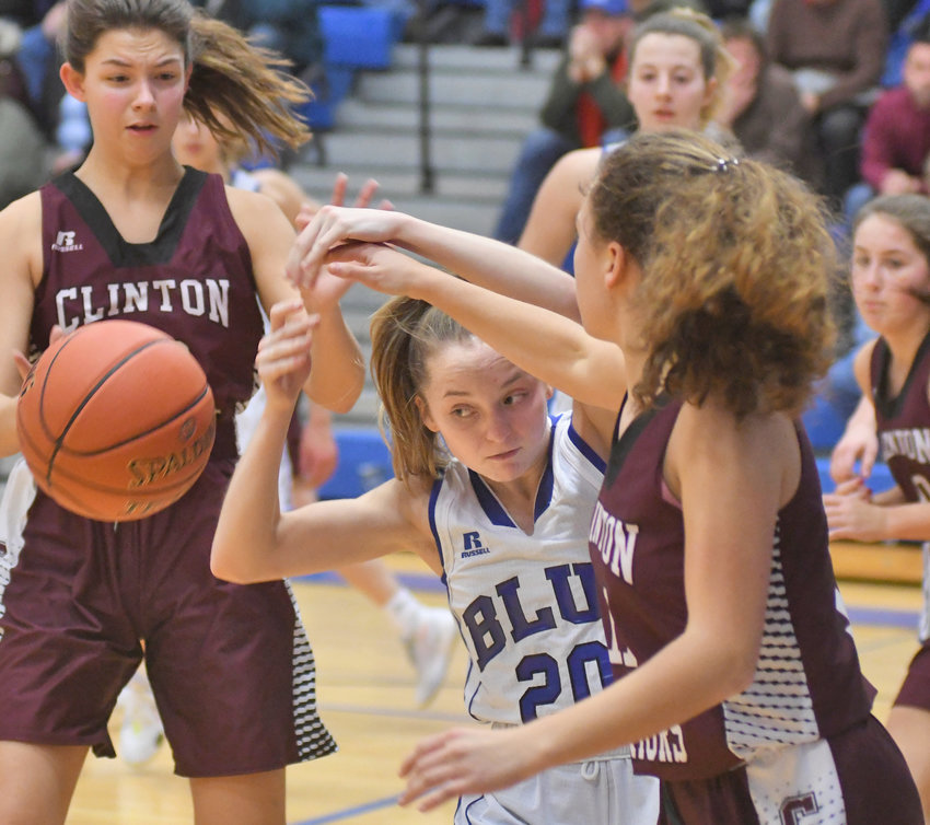 BATTLE FOR POSSESSION — Camden's Mackenzie Mix goes for a rebound with Clinton's Megan Bremer, right, during a non-league game on Wednesday, Jan. 8 in Camden. The Warriors prevailed, 43-39.