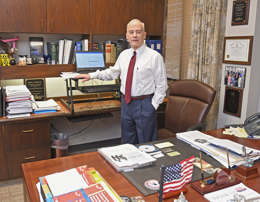 LOOKING FORWARD — Mark Pfisterer in his office after 42 years at AmeriCU. At some point this year, Pfisterer said he will officially retire and hand off the reins to a successor that is currently being sought.