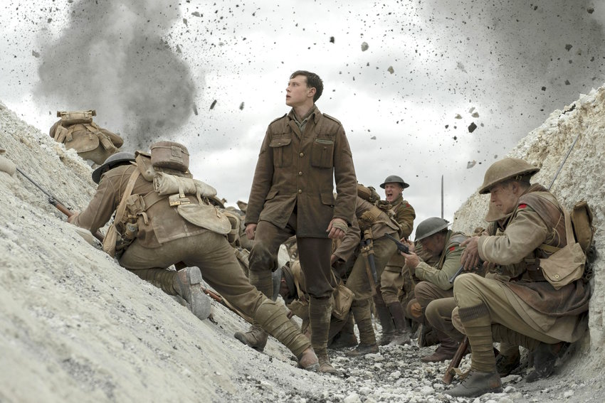 """HEAT OF BATTLE — George MacKay as Schofield, center, in a scene from """"1917,"""" directed by Sam Mendes."""