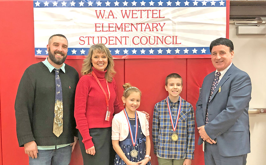 ORATORICAL COMPETITION WINNERS — W.A. Wettel Elementary School fifth-grader Nathan Meacham, second from right, won first place in an oratorical competition at the school as part of celebrating the upcoming Martin Luther King, Jr. Day. In second place was fifth-grader Alyssa Lessels, third from right. With them, from left, are teacher John Protheroe and student council advisor Michelle Martin, while Wettel school Principal Vince Pompo is at far right.