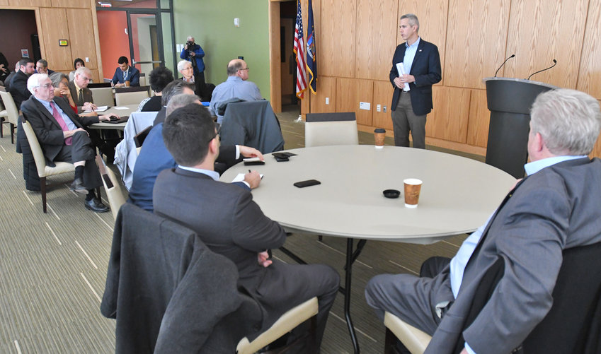 "CONGRESSMAN HOSTS ROUNDTABLE DISCUSSION — U.S. Rep. Anthony Brindisi, standing at center, speaks to attendees at the start of a ""defense summit"" meeting he hosted Thursday at Mohawk Valley Community College's Rome campus."