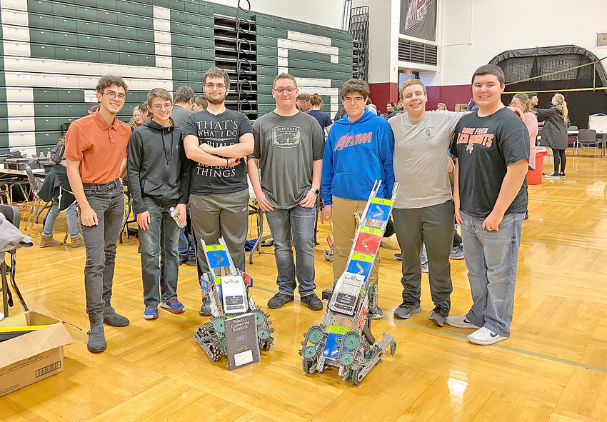 "SUCCESS FOR RFA ROBOTICS — Among members of Rome Free Academy's two robotics teams that were successful at a recent upstate competition in Elmira, from left: Dominick Cangialosi, Bruce Vinci, and Chris Incorvaia, who are on the ""Dusk Knights"" team; Mike Nason, Antonio Cicci, Jon Denton and Nick Smolinski, who are on the ""Black Knights"" team."