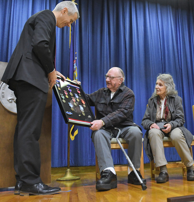 HONORED — Congressman Brindisi with military service medals for Rome resident Hugh Aikens - who served in WWII and the Korean War - with his wife June at right.