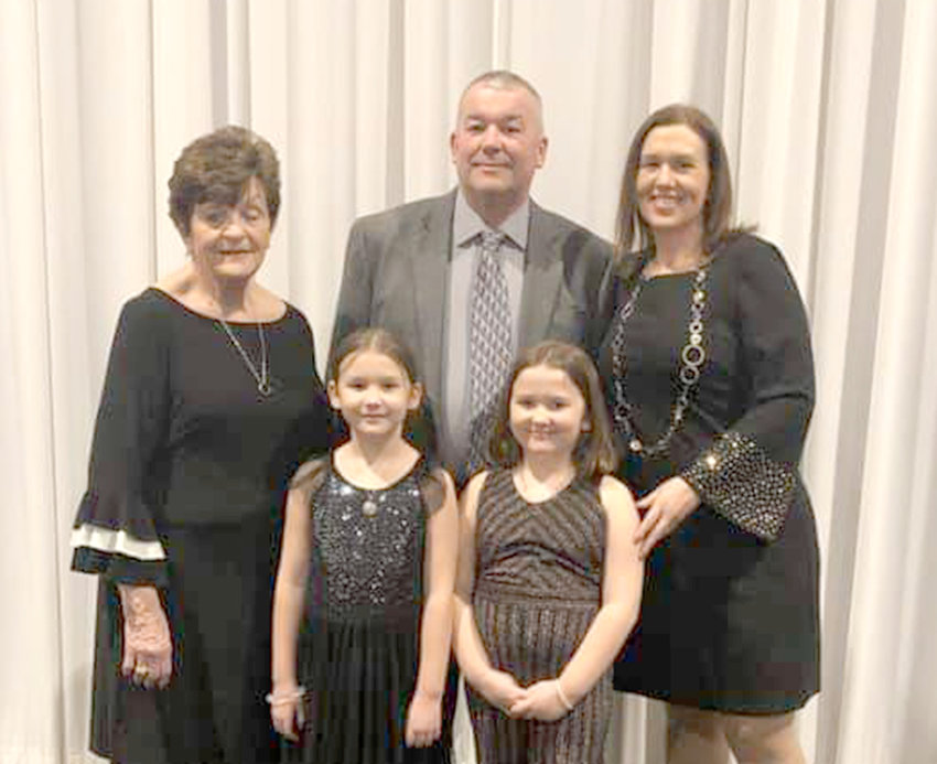 AWARD WINNER —Tim Dean, of the Boonville-Oneida County Fair board is surrounding by his family at an awards ceremony at the New York State Association of Agricultural Fairs held earlier this month in Rochester.  Dean received the 2019 Showperson of the Year Award at the annual event.