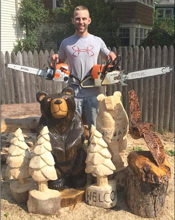CARVED ART — Beech Wayland of Beech's Chainsaw Carvings will be at the 16th annual Central New York Sportsman Show.