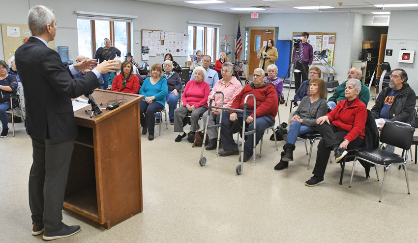 "TELL US MORE — Rep. Anthony J. Brindisi, D-22, Utica, talks with some senior citizens at the Copper City Community Connection, 305 E. Locust St., in Rome today. Brindisi was at the center to roll out his ""The Gray New Deal"" proposal, which he said will offer necessary protections to aging Americans."