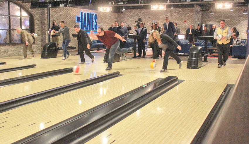 THE LANES — Employees at the Yellow Brick Road Casino roll their balls down the new bowling lanes at The Lanes entertainment venue on Tuesday at the grand opening of the facility's  expanded entertainment area. The casino is located at 800 W. Genesee St. in Chittenango.