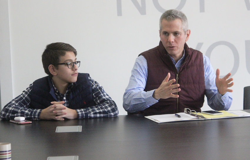 MADISON COUNTY CONVERSATION — Congressman Anthony Brindisi, joined by his son, sits down with local farmers and businesses to talk agri-business in Madison County at the Partnership for Community Development in Hamilton.