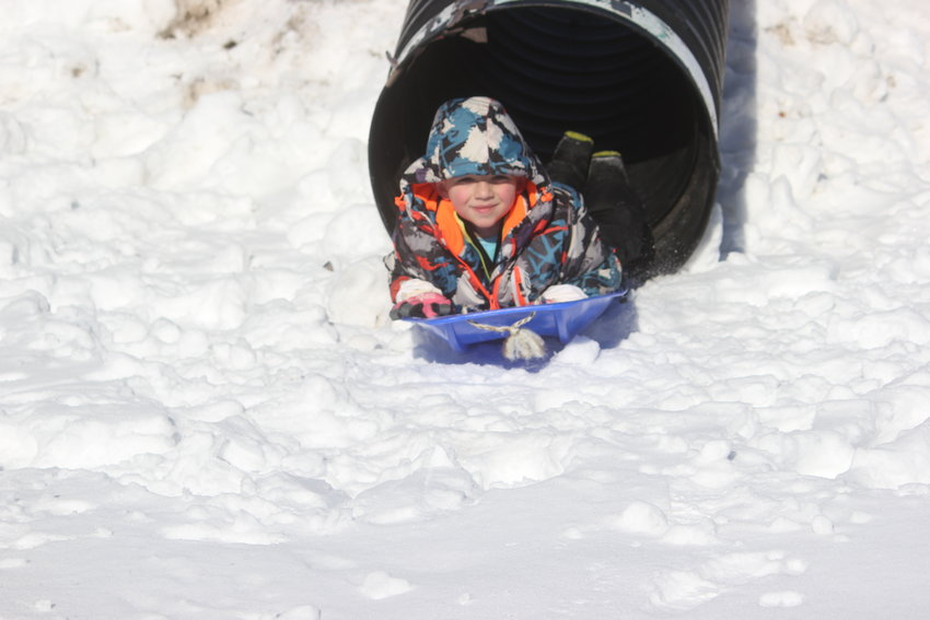 SLEDDING — Six-year-old Kruz Cesario sleds through a makeshift tunnel during festivities this weekend at the Great Swamp Conservancy's Winter Hibernation Festival. The event drew dozens of children as well as adults for some indoor and outdoor fun. Mother Nature even cooperated with sunny skies and mild temperatures. Additional photos, page 2 and online at www.romesentinel.com.