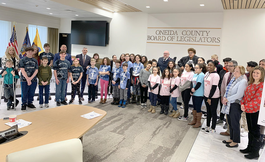 YOUNG VOLUNTEERS — Some of the young people involved in the 2019 Children Care Initiative of the Oneida County Youth Bureau are honored during a Tuesday morning recognition in the legislative board room at the county office building in Utica. In 2019, 1,641 youth devoted 11,096 hours of community service in the initiative.
