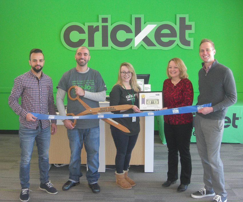 READY FOR BUSINESS — Representatives of the Rome Area Chamber of Commerce help the owners and employees of the Cell Phones for Less Cricket Wireless store at 142 Black River Blvd. cut the ribbon and present a First Dollar of Profit certificate during a grand opening ceremony on Friday. From left: Musa Almaliti, co-owner; Edwin Baez, team leader; Kaylyn Hudson, district manager; Sue McLoughlin, chair of chamber's Membership Committee; and Wes Cupp, chairman of the chamber board. Cell Phones for Less, Inc. is an authorized Cricket Wireless retailer. Store hours are Monday to Saturday, 10 a.m. to 8 p.m. and Sunday, 11 a.m. to 5 p.m.
