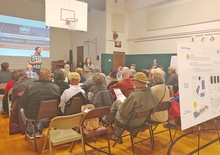 SOLAR MEETING — Representatives of Apex Clean Energy speak during a meeting at Boonville Elementary School Tuesday to share with residents plans for a proposed solar-power project near the Adirondack Beverage Company.