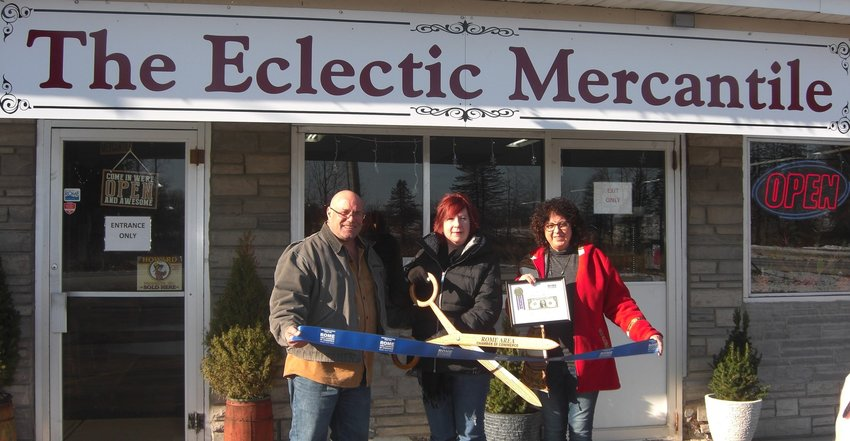 FIRST DOLLAR OF PROFIT — The Rome Area Chamber of Commerce was on hand recently along with the owners of The Eclectic Mercantile to cut the ribbon and celebrate its opening at 8585 Turin Road. From left are Darren and Valerie Pollack, store owners, and Maria Ringlund, from The Photo Shoppe-Fusion Art & Gift Gallery and representing the chamber. The Eclectic Mercantile is a brother store to The Eclectic Chic, and offers a wide array of eclectic and rustic merchandise, antiques and other items. The Eclectic Mercantile is open Tuesday through Sunday, from 10 a.m. to 5 p.m. For information, call the store at 315-371-0029.
