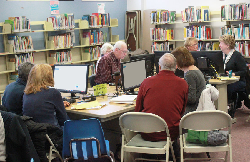 TAX COUNSELING — Local seniors get help with their 2019 taxes at the Tax Counseling for the Elderly program at the Oneida Public Library on Monday. The free program, sponsored by the Cornell Cooperative Extension, helps those over 60 file their taxes. The next session at the library will take place on Wednesday.