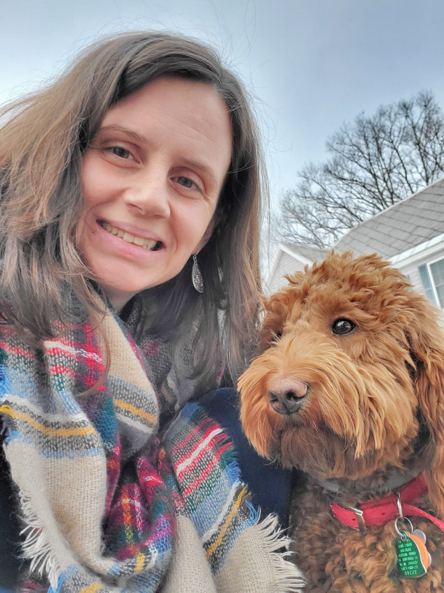 FETCHING ATTENTION AT VVS — Red, a labradoodle who is a new therapy dog in the Vernon-Verona-Sherrill school district, is shown here with VVS social worker Brandy-Lee Lappin, who acquired Red and handles him at school.