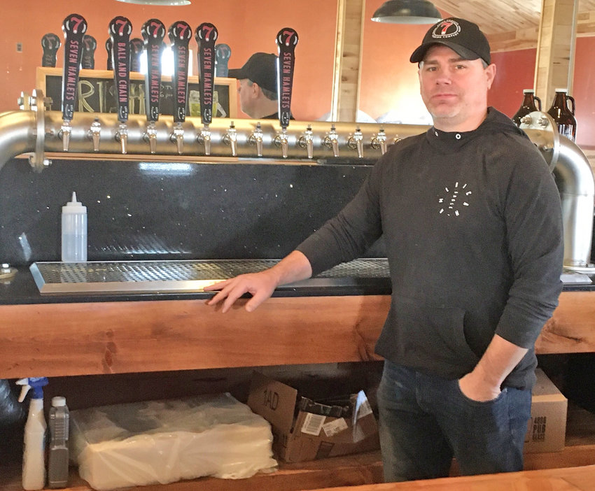OPENING SOON — Matthew Taylor, co-owner of 7 Hamlets Brewing Co. off Route 233, stands at what will soon be the variety of beers on tap at his establishment.  Taylor and co-owner Keith Richards are hoping to celebrate their business' grand opening April 4.