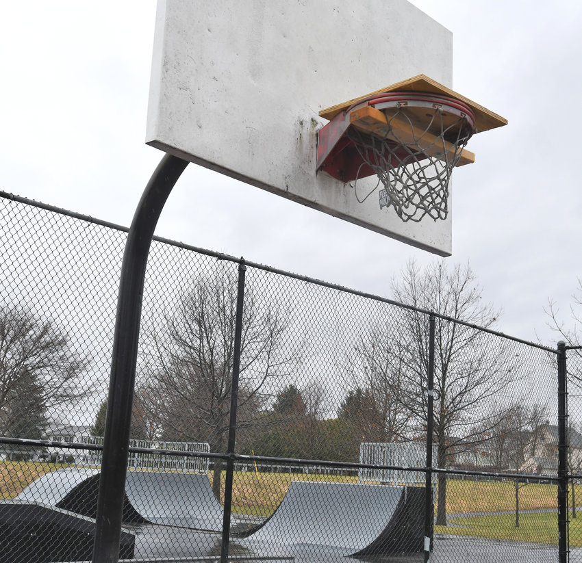 BOARDED UP — City crews have boarded up the basketball rims at Pinti Field, shown here on  Monday morning, to keep people off of the courts and engaging in social distancing, according to city officials.  On Friday, Mayor Jacqueline M. Izzo extended a state of emergency order for the city which includes prohibiting use of the city's basketball courts, ball fields and other recreational facilities.