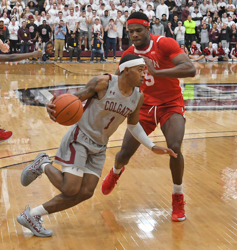 DRIVING TO THE BASKET — Colgate's Jordan Burns drives to the basket against Boston University's Walter Whyte during the Patriot League Tournament title game on March 11. Burns scored a game-high 21 points for the Raiders, but the Terriers won, 64-61.