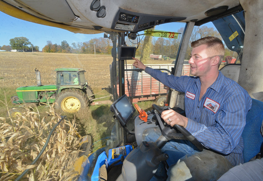 IMPACTED BY COVID-19 — Area dairy farmer Nicholas Finn, shown here cutting down corn silage in the fall at his farm in Holland Patent, is among area dairy farmers hard hit by the wide-reaching impacts of the coronavirus.