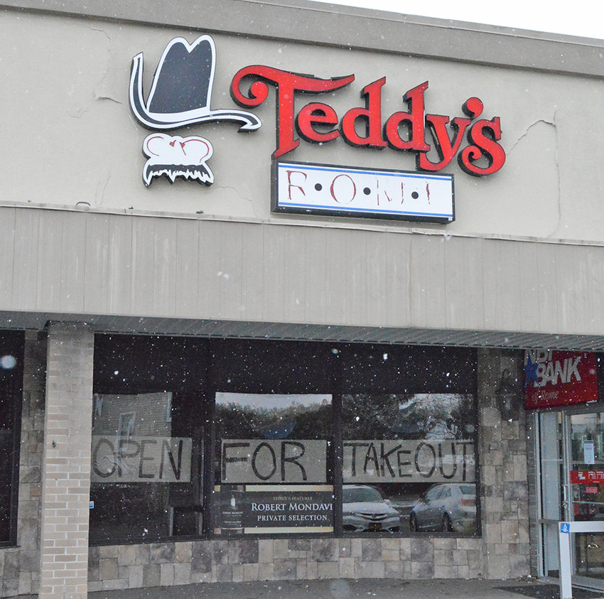 COME FOR CURBSIDE — Teddy's of Rome restaurant on Black River Boulevard is one of several locally-owned restaurants offering take-out options during the shutdown caused by the coronavirus pandemic.  A sign welcomes customers.  With a quick call to inform staff, employees will run food out to waiting cars in the parking lot.
