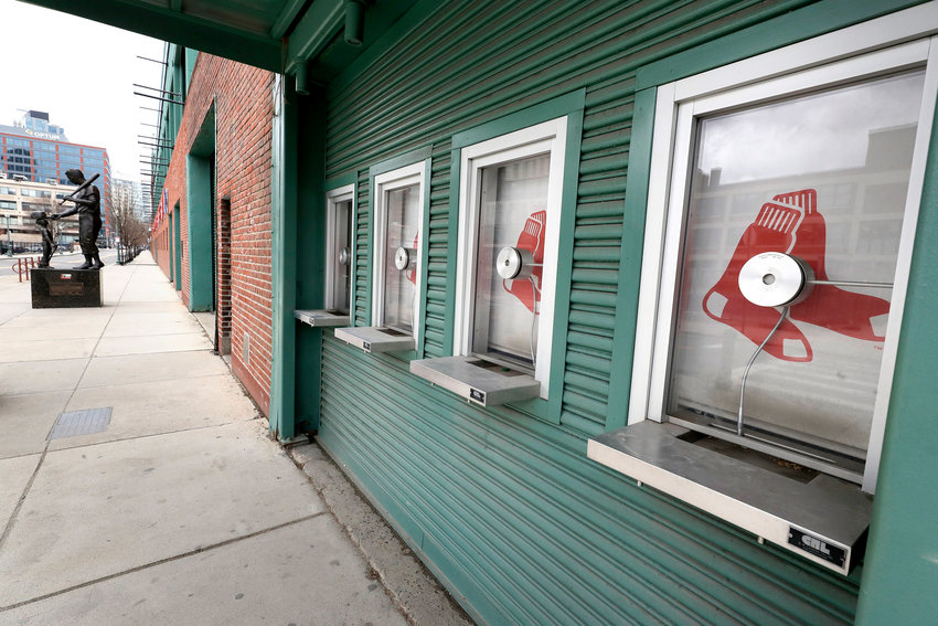 CLOSED — Ticket windows were closed at Fenway Park on March 25 in Boston. There were empty ballparks on what was supposed to be Major League Baseball's opening day, with the start of the Major League Baseball regular season indefinitely on hold because of the coronavirus pandemic.