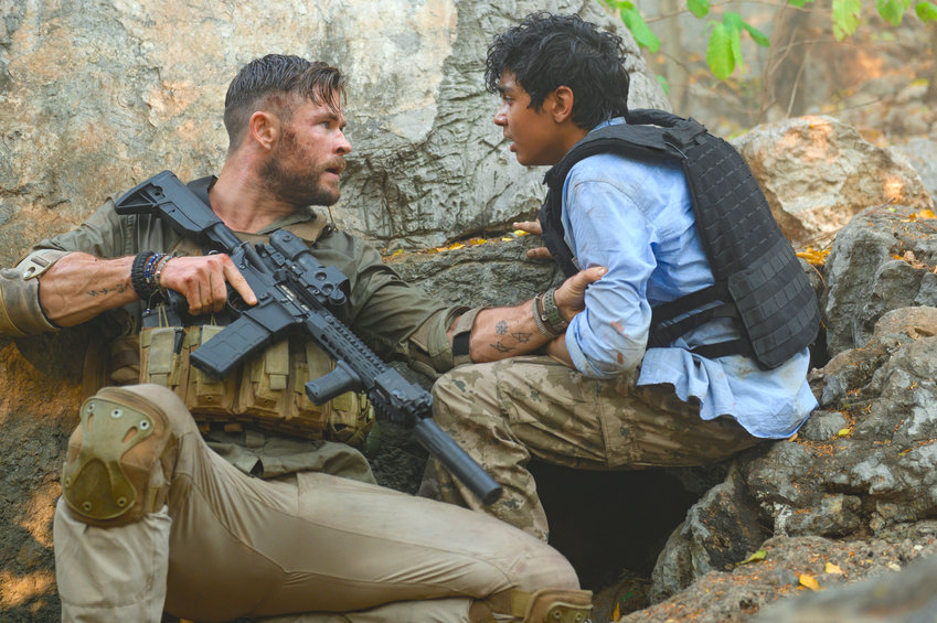 """ON NETFLIX — Chris Hemsworth, left, and Rudhraksh Jaiswal in a scene from """"Extraction."""""""