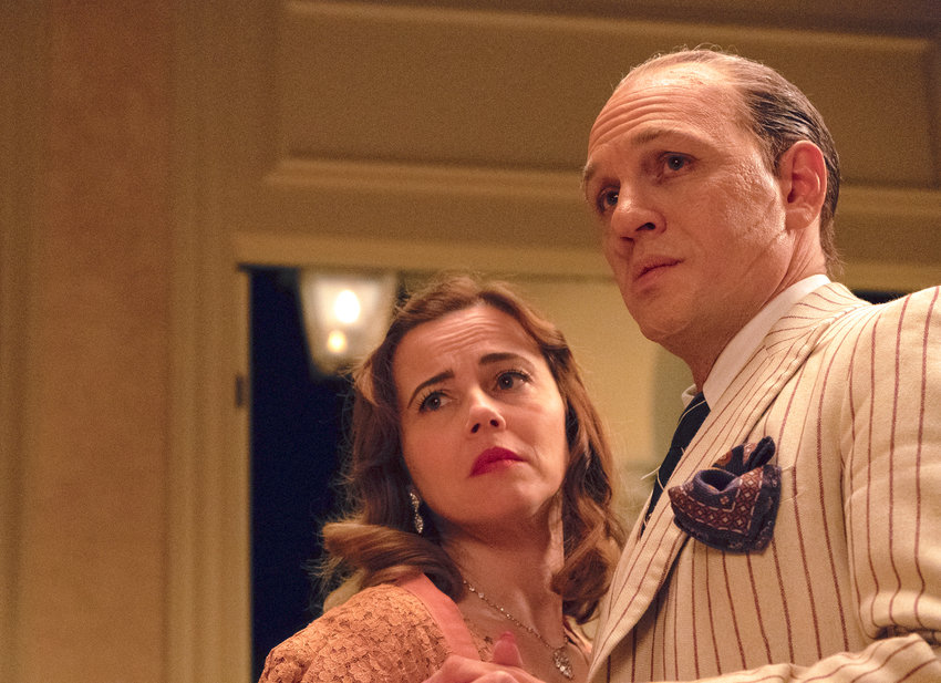"""CAPONE's epilogue — Linda Cardellini, left, and Tom Hardy in a scene from """"Capone."""""""