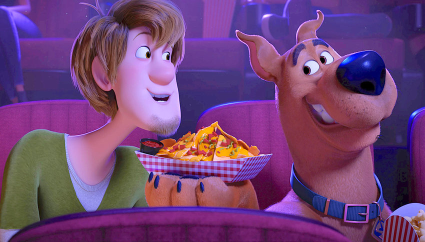 """DYNAMIC DUO — Characters Shaggy, voiced by Will Forte, left, and Scooby-Doo, voiced by Frank Welker, in a scene from the animated film """"Scoob!"""""""