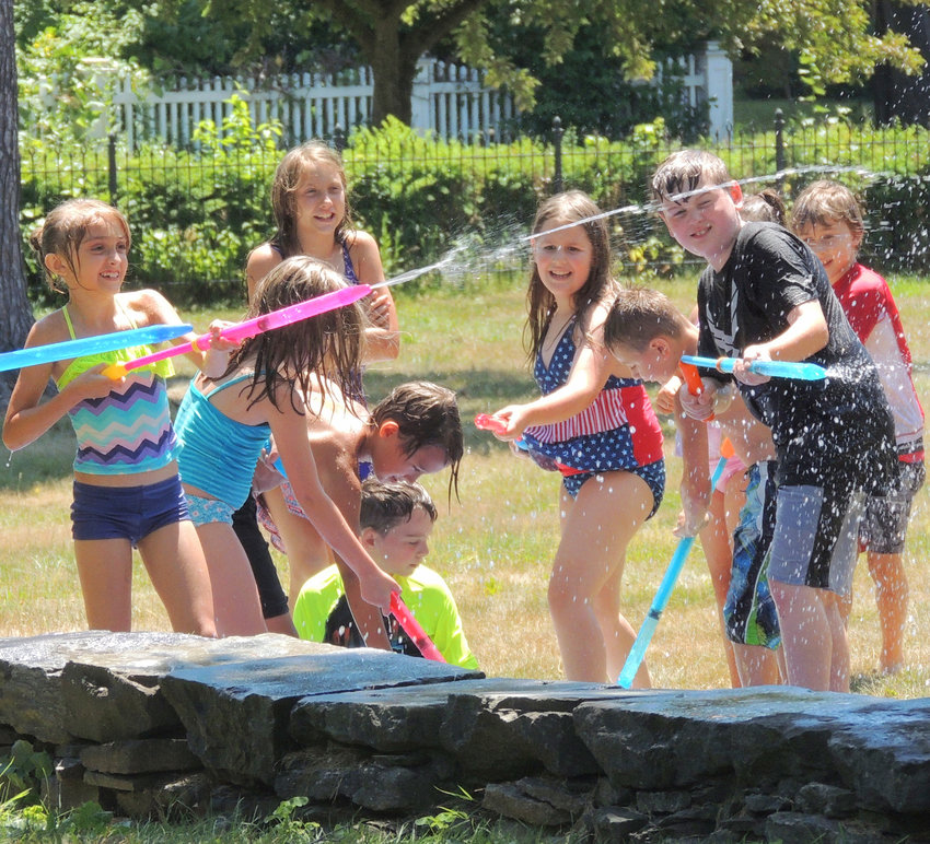 ART AND FUN — Attendees enjoy some outdoor water fun at the RACC's Artletics Summer Camp. This year the camp is planned for June 29-Aug. 20 (Monday-Thursday, 8 week program, 9 a.m. to 3 p.m.).