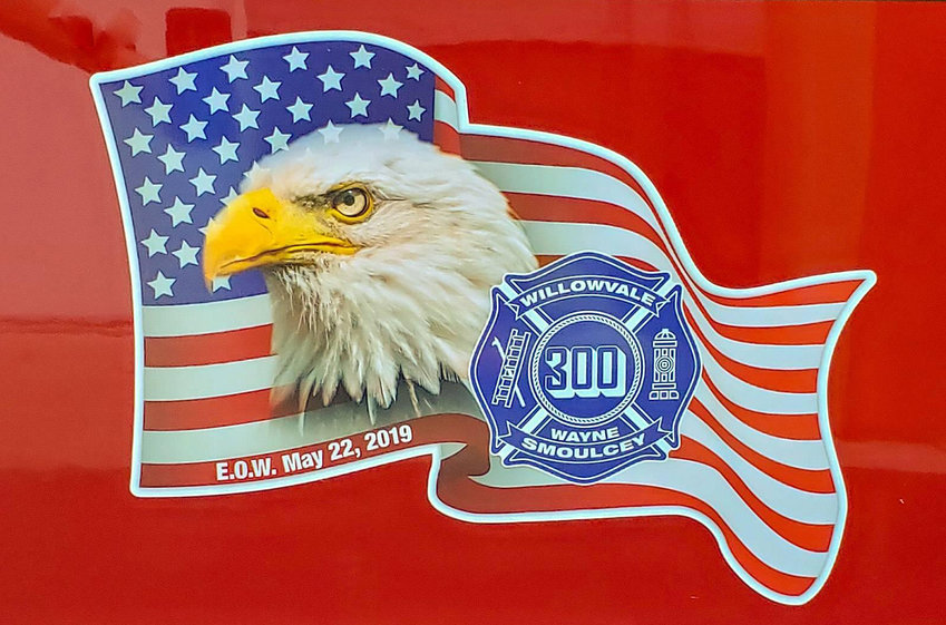 """'LAST OF THE 300S' — The Willowvale Fire Department recently unveiled a new tanker truck with this memorial decal honoring the late chief Wayne Smoulcey, who died of cancer in 2019. The decal prominently features Willowvale's 3-digit chiefs number — 300 — and the department called Smoulcey the """"last of the 300s"""" when they shared the truck on social media."""