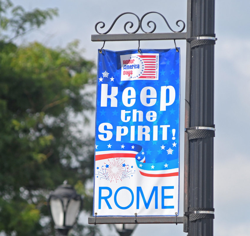 'KEEP THE SPIRIT' — Freshly hung banners on North James Street this morning provide a patriotic-themed, inspirational message for passers-by. Traditionally, Honor America Days organizers hang banners to promote Rome's signature celebration; however, with this year's event scuttled because of the COVID-19 pandemic, officials, aided by a donation from Woodmen Insurance, opted for an inspirational theme.