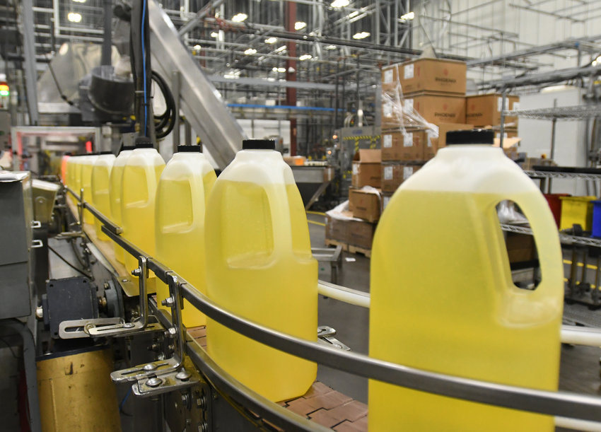 READY FOR IDs — Jugs of oil are on the line to get labeled, at Sovena USA Inc.'s site at Griffiss park.