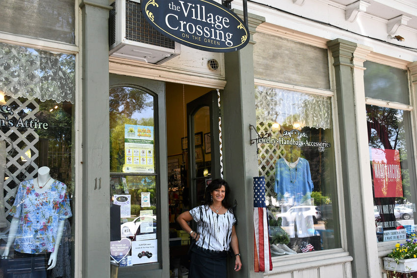OPPORTUNITY AWAITS —Standing in the doorway of the Village Crossing On the Green fashion boutique, is owner, Joyce Polanowicz, who'll be retiring later this year after bringing the women's clothing store to 11 W. Park Row in Clinton 11 years ago. She hopes to pass along what's become a staple storefront along shopper's row to someone with life experience and energy.
