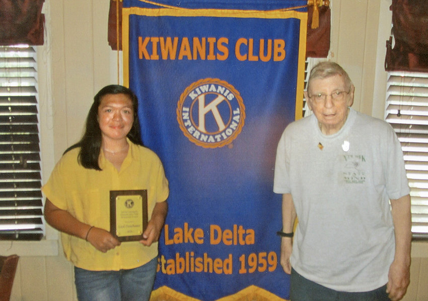 AWARD RECIPIENT —Liesl Froschauer, left, receives the Sylvia Colangelo Award from longtime Lake Delta Kiwanis Club member and Key Club adviser Paul Colangelo during a recent club meeting.