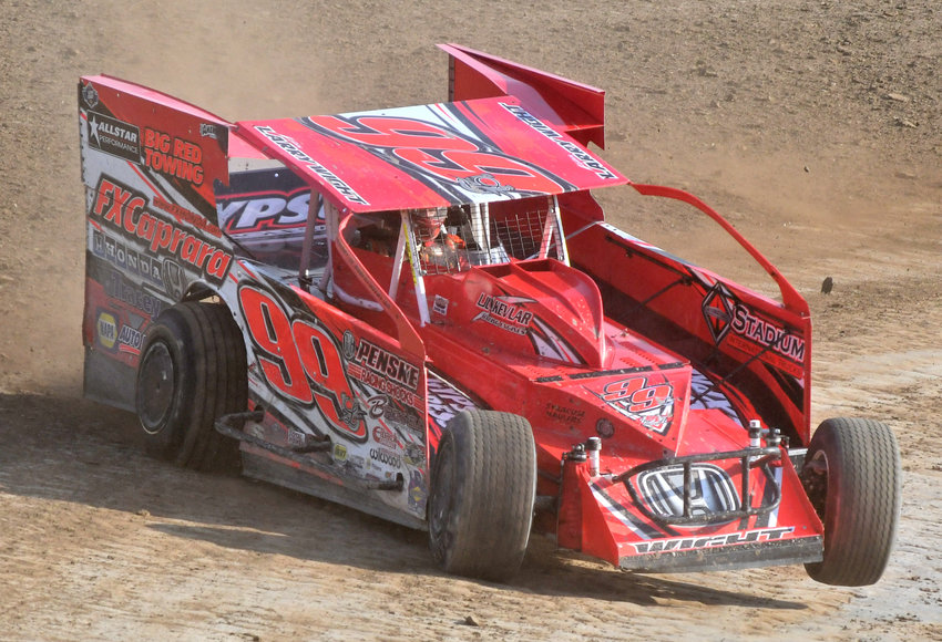 PRACTICE TIME — Dirt racing star Larry Wight throws his car into turn three on Thursday, July 23 as he and several teams from many different racing divisions took the opportunity to work on their race set up.