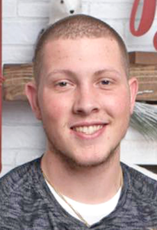 VICTIM REMEMBERED — A candlelight vigil was held for murder victim Tyler A. McBain, age 22, at a park in the City of Oneida Wednesday night. According to state police, one person has been charged with murder so far, while the search remains ongoing for a second person.