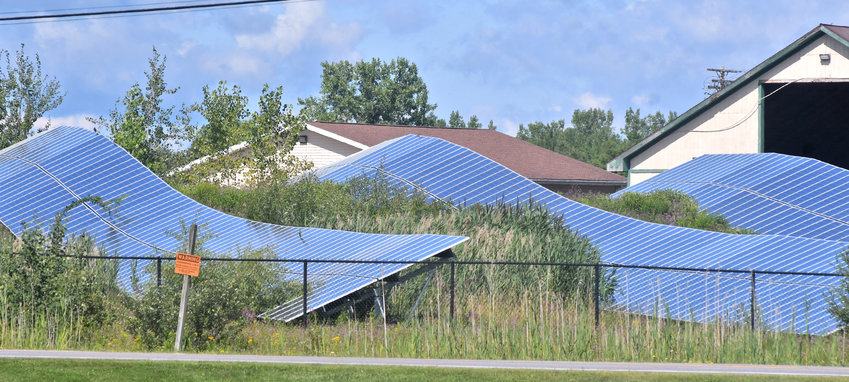 SUN POWER — How to tax community solar projects containing solar panels like these off Judd Road in Whitestown is increasingly a question for local governments. The Oneida County Industrial Development Agency has scheduled a public hearing for Monday on its proposed policy regarding requests for tax incentives for such projects, which allow renters and homeowners without their own solar power equipment to use electricity from solar farms.