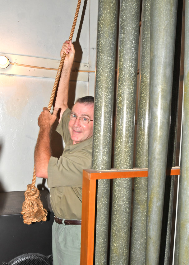 REMEMBERING VICTIMS — The Rev. Samuel Pendergrast, pastor of Rome First Presbyterian Church, is seen pulling the bell from the pipe organ room full of pipes at the church. The pastor has rung the church bells at noon since the beginning of the COVID-19 pandemic, to honor area individuals and families, as well as essential workers and first responders.