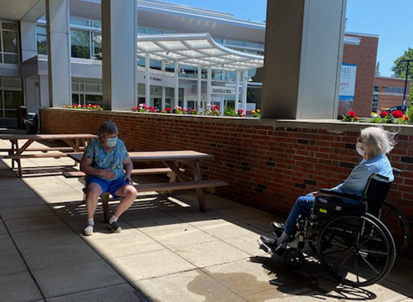 CATCHING UP — Betty Irving, right, visits with her daughter Tina, outside at Rome Memorial Hospital's Bartlett Wing recently.  The hospital's Residential Health Care Facility is helping its residents reconnect with friends and family.