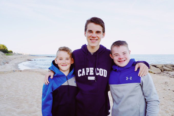 Luke Radel with his brothers John Paul (left) and Mark (right).