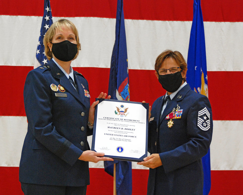 SERVICE HAILED — Maj. Gen. Dawn Deskins, left, deputy director of the Air National Guard, presents a retirement certificate to Chief Master Sgt. Maureen Dooley, of the New York Air National Guard Command, during a ceremony in Latham on Friday.