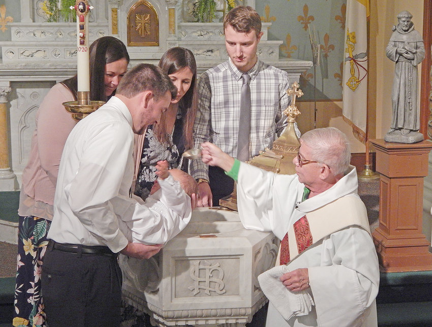 HISTORIC — On Sept. 20, St. Mary's-St. Peter's parish held a baptism using the original 1897 baptismal font for the first time in over 40 years. From left, Godmother Ashley Engle; father, Neil Kubik; mother, Brianna Kubik; infant Isaac Joseph Kubik; Godfather, Jim Brognano; and Deacon Nicholas Rosher.