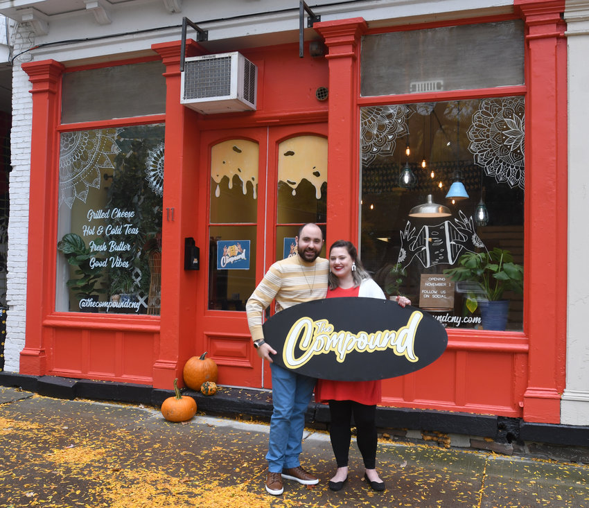 COMING SOON — Husband-and-wife team Sharrone and Anna Sofer stand in front of what will soon be their new cafe — The Compound — at 11 W. Park Row.  The Sofers plan to serve breakfast and lunch while featuring their homemade gourmet butters used to make their signature toasted cheese sandwiches.  The Compound will open on Nov. 1.