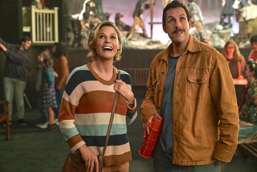 "Feel-good Halloween movie — Julie Bowen as Violet Valentine and Adam Sandler as Hubie Dubois in a scene from ""Hubie Halloween."""