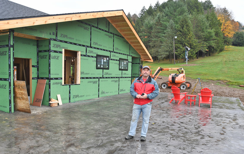 UNDER CONSTRUCTION — Tim Woods, owner of Woods Valley Ski Center on Route 46 in Westernville, shows off the ski center's new patio, which will be heated. Construction that included renovations and an expansion of the lodge began in June and will be complete for the start of ski season next month.